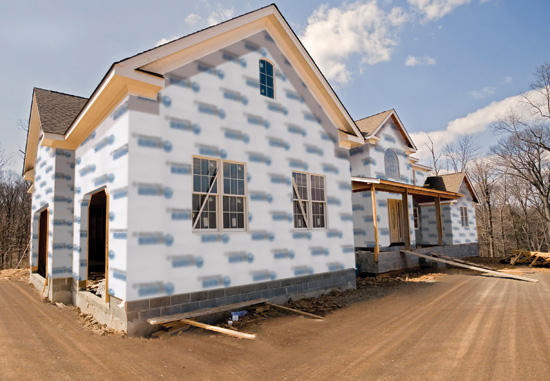 A large house with sheathing, windows and doors