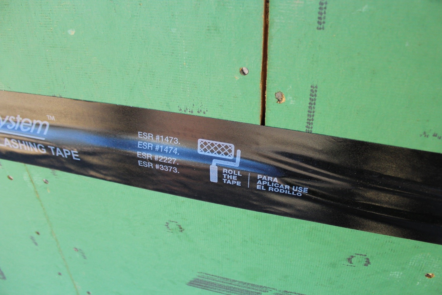 Zip System Flashing Tape With Graphic Indicating The Requirement To Roll